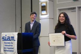 Andrea Minca, the Andrew Schultz '36 PhD '41 Sesquicentennial Fellow in ORIE, receives the SIAG/FME Early Career Award.   At left, Mike Ludkovski, chair of SIAG/FME.