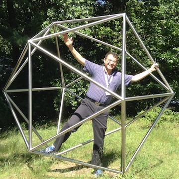 Jesús De Loera standing inside icosahedron made of tubes
